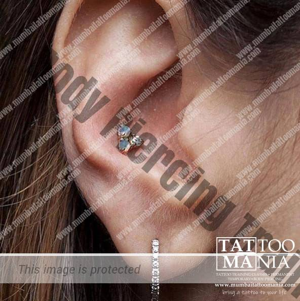 conch piercing and ear piercing done at tattoo mania & body piercing training institute at thane